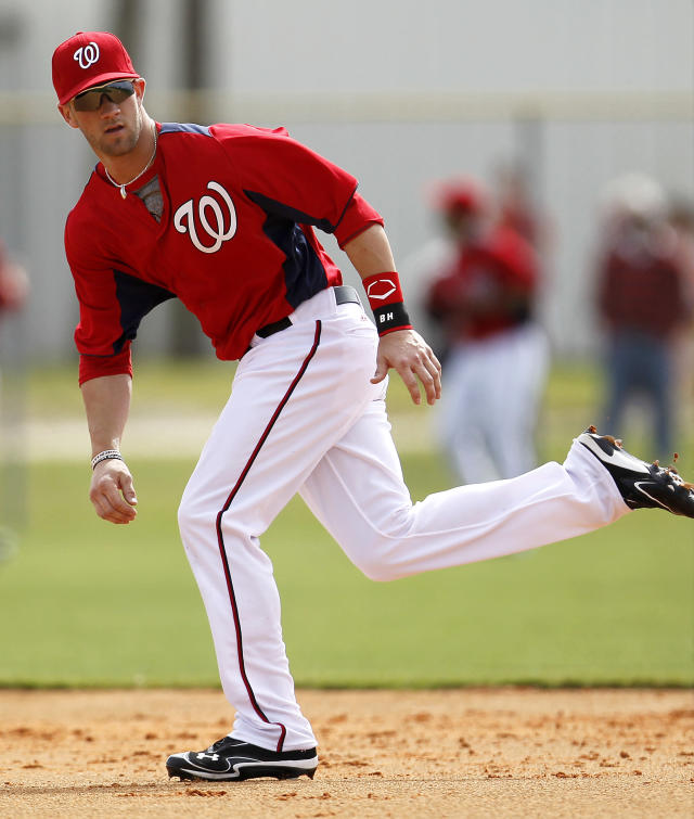Bryce Harper, a 19-year-old Washington Nationals prospect, runs the bases during the team's first official full squad workout at spring training baseball, Saturday, Feb. 25, 2012, in Viera, Fla. (AP Photo/Julio Cortez)