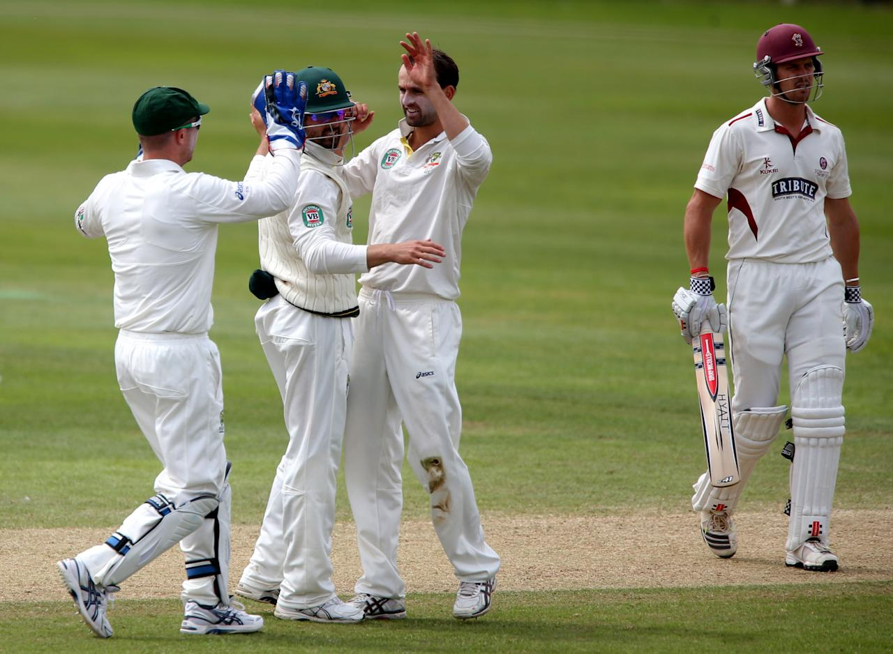 Somerset batsman Nick Compton shows his dejection after he was trapped LBW by Australian bowler Nathan Lyon (centre) during the International Tour match at the County Ground, Taunton.
