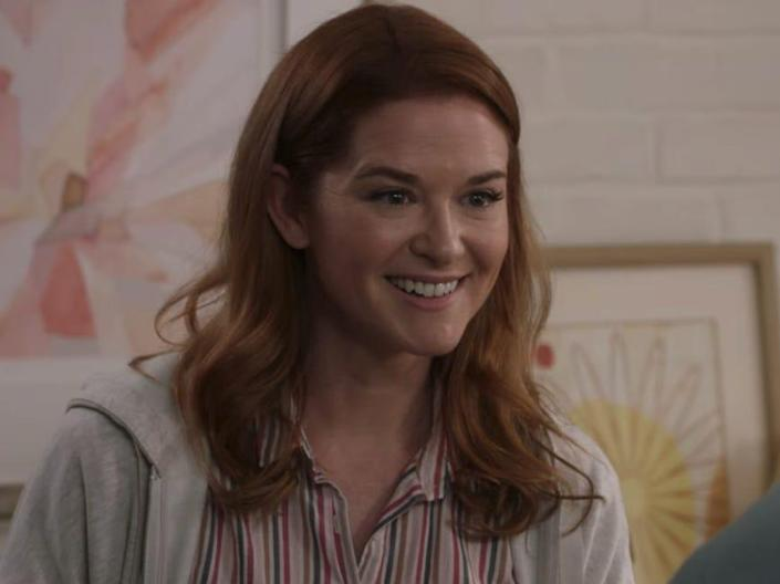 Sarah Drew as April on Greys Anatomy wearing a striped button down and gray jacket