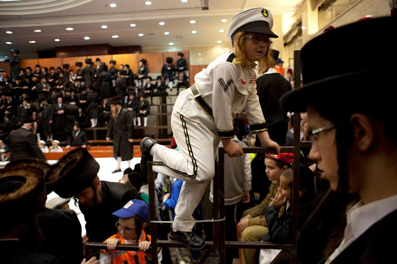 An ultra-Orthodox Jewish boy wears a costume while celebrating the Purim festival at a synagogue in the town of Bnei Brak near Tel Aviv, Israel, late Sunday, Feb. 24, 2013. (AP Photo/Ariel Schalit)