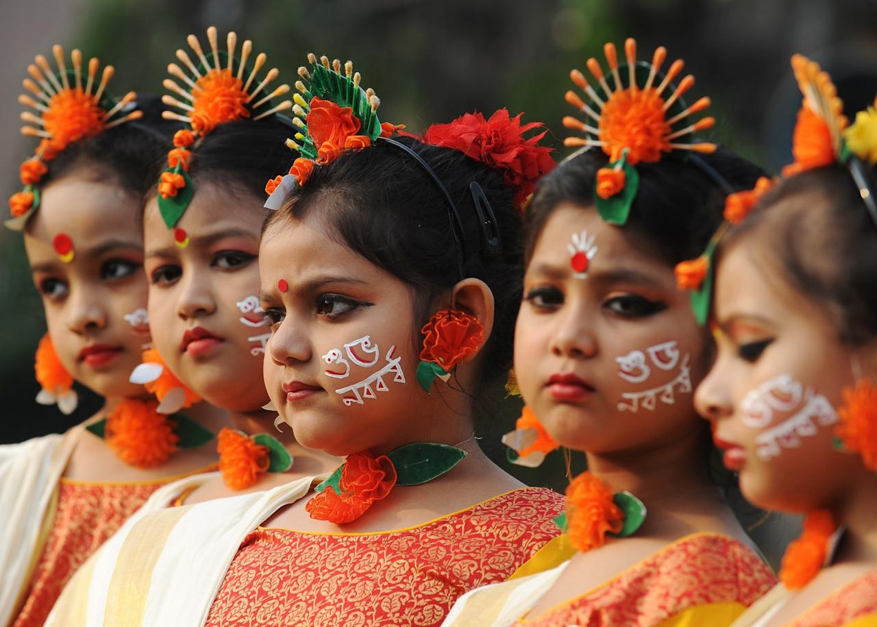 <p>Indian Hindu Bengali girls in traditional dress take part celebrations to mark Bengali New Year in Siliguri on April 15, 2017. </p>