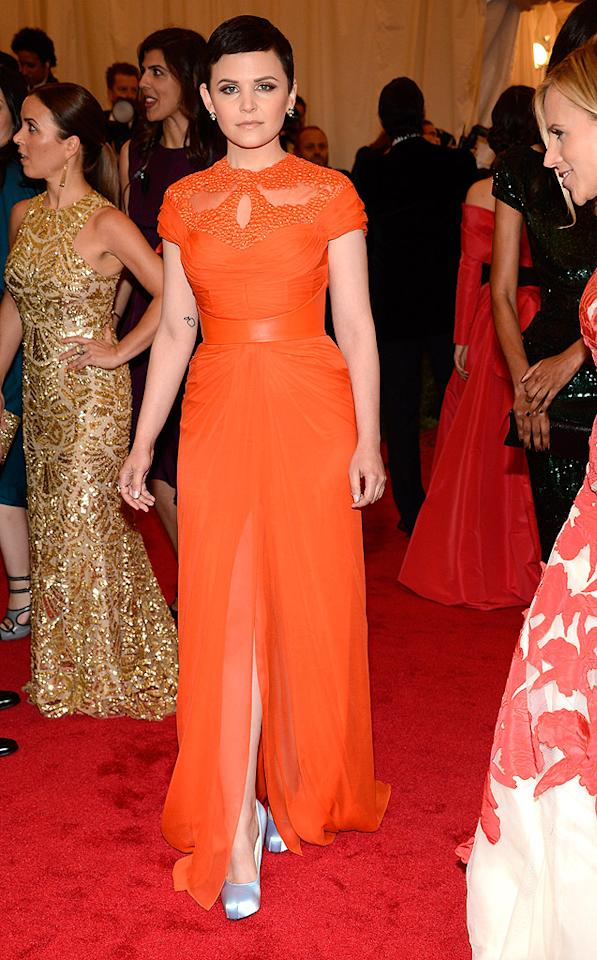 "Sevigny's former ""Big Love"" co-star Ginnifer Goodwin paired her pixie cut with a bold orange Monique Lhuillier gown. She finished the ensemble with simple earrings and silver pumps."
