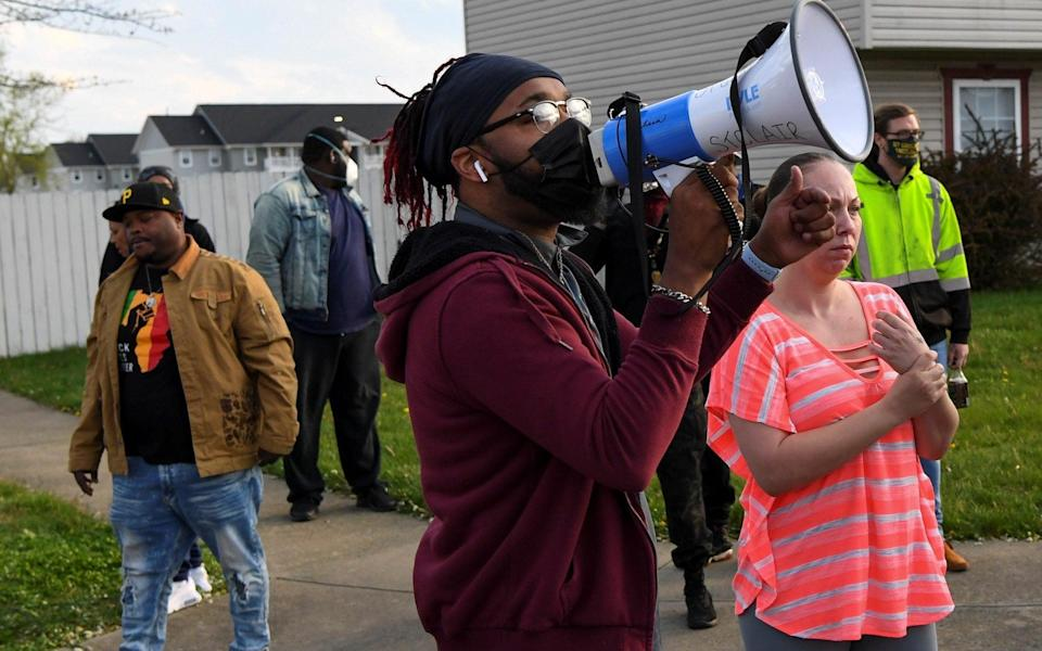 Crowds react as investigators work at the scene where Makiyah Bryant was fatally shot by a police officer in Columbus - Reuters