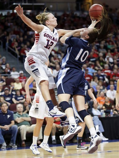 Gonzaga's Taelor Karr (12) attempts to block a reverse layup by San Diego's Amy Kame during the first half of the West Coast Conference tournament championship NCAA college basketball game, Monday, March 11, 2013, in Las Vegas. (AP Photo/Julie Jacobson)