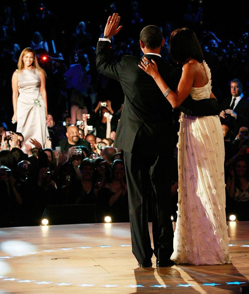 """<p>President Obama celebrated his historic win as the first Black President of the United States in 2009. Wearing a white chiffon evening gown designed by Jason Wu, First Lady Michelle Obama joined the President for the first dance to """"At Last"""" by Etta James, which Beyoncé sang. </p>"""
