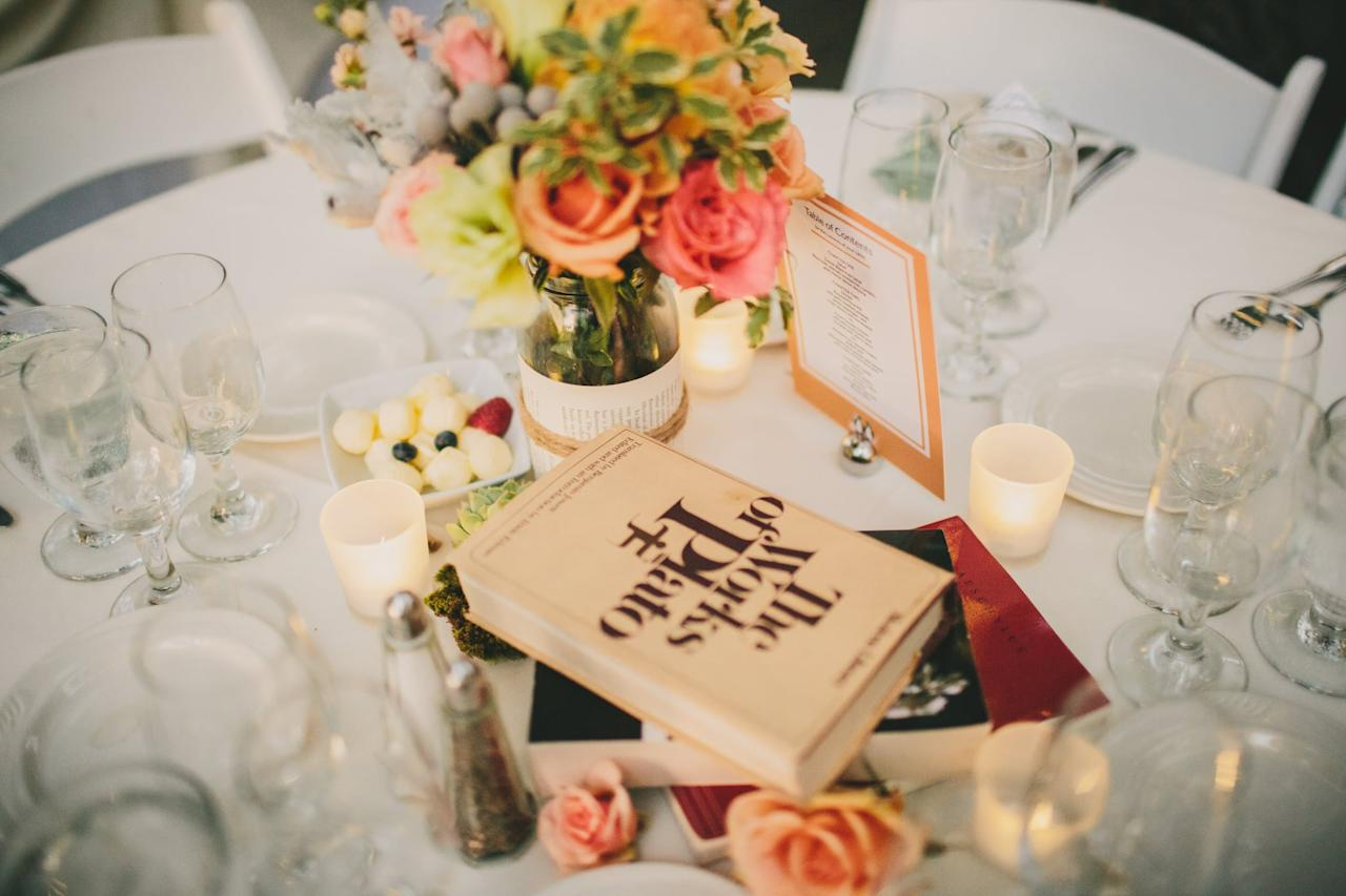 <p>Add flowers and candles to a book centerpiece for a romantic setting.</p>