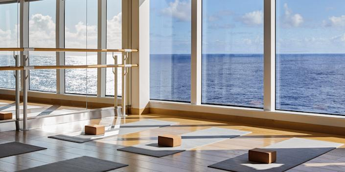 yoga mat and blocks in a room of windows and mirrors