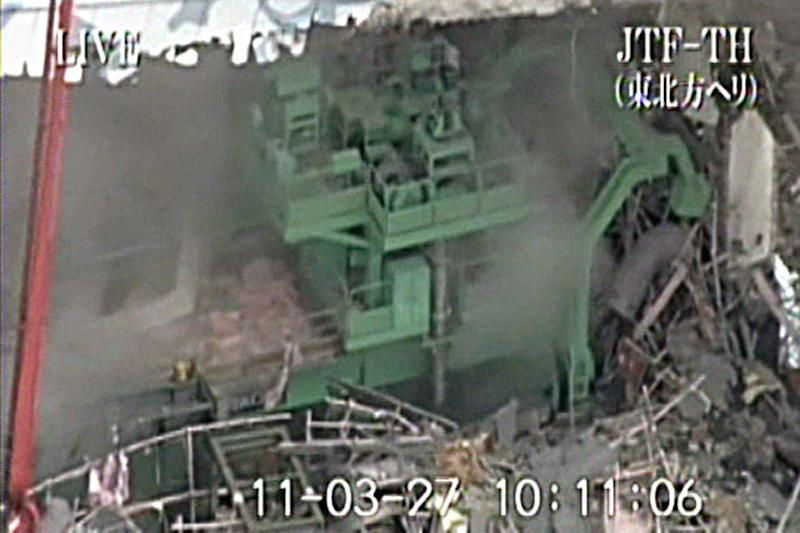 This image released by Japan Ground Self-Defense Force via Kyodo News shows the inside of Unit 4 at the stricken Fukushima Dai-ichi nuclear power plant in Okumamachi, Fukushima Prefecture, northeastern Japan, Sunday, March 27, 2011. (AP Photo/Japan Ground Self-Defense Force via Kyodo News) JAPAN OUT, MANDATORY CREDIT, NO LICENSING IN CHINA, HONG KONG, JAPAN, SOUTH KOREA AND FRANCE