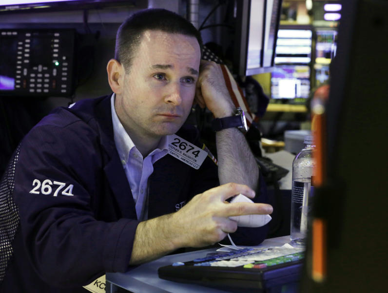 In this Thursday, Aug. 15, 2013, photo, specialist Stephen Naughton works at his post on the floor of the New York Stock Exchange. Expectations that the U.S. Federal Reserve will start to phase out its monetary stimulus had a mostly negative impact on global stock markets Friday Aug. 16, 2013. (AP Photo/Richard Drew)