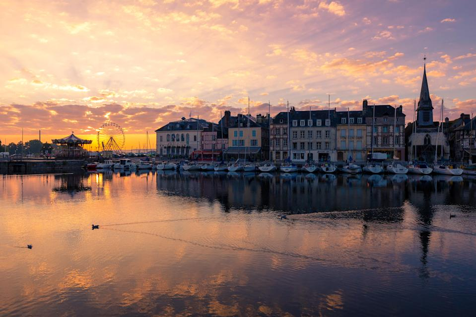 The sun sets over Deauville harbour (Getty Images)