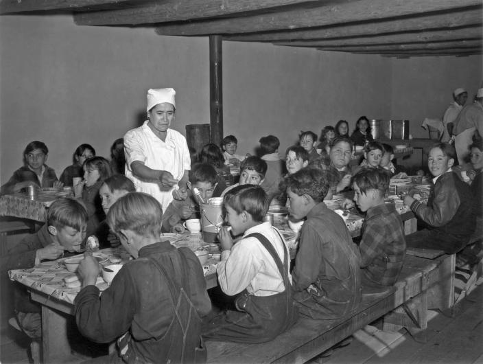Image: Schoolchildren eat hot school lunches made up primarily of food from the surplus commodities program at a school in Peñasco, N. M. in December 1941. (USDA)
