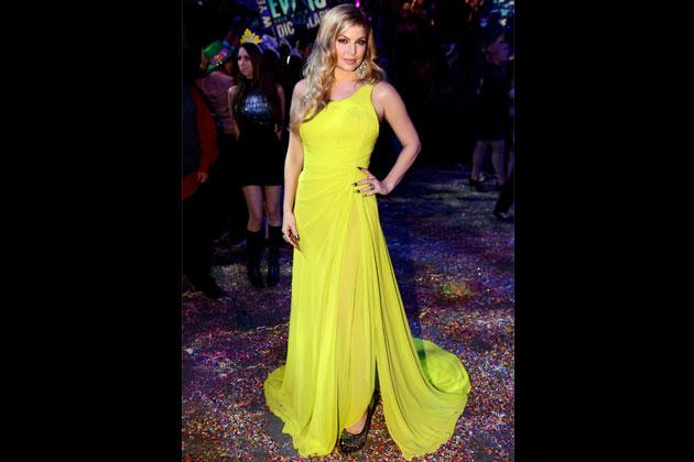 Singer Fergie hosts Dick Clark's New Year's Rockin' Eve at CBS studios last December 31, 2012 in a bright and stunning assymetrical dress by Oliver Tolentino.