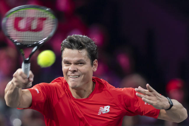 Team world's Milos Raonic returns a ball to Team Europe's Rafael Nadal during their singles match at the Laver Cup tennis event, in Geneva, Switzerland, Saturday, Sept. 21, 2019. (Martial Trezzini/Keystone via AP)