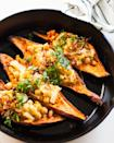 """<p>You need only four additional ingredients to whip up these tasty stuffed sweet potatoes: shallots, cauliflower, chickpeas, and a satay simmer sauce. Frying the shallots in a pan gives each bite a satisfying crunch.</p><p><strong>Get the recipe at <a href=""""https://sweetpotatosoul.com/easy-stuffed-sweet-potatoes/"""" rel=""""nofollow noopener"""" target=""""_blank"""" data-ylk=""""slk:Sweet Potato Soul"""" class=""""link rapid-noclick-resp"""">Sweet Potato Soul</a>.</strong></p><p><a class=""""link rapid-noclick-resp"""" href=""""https://go.redirectingat.com?id=74968X1596630&url=https%3A%2F%2Fwww.walmart.com%2Fbrowse%2Fhome%2Fskillets-frying-pans%2F4044_623679_8140341_1675139&sref=https%3A%2F%2Fwww.thepioneerwoman.com%2Ffood-cooking%2Fmeals-menus%2Fg36876289%2Fsweet-potato-side-dishes%2F"""" rel=""""nofollow noopener"""" target=""""_blank"""" data-ylk=""""slk:SHOP SKILLETS"""">SHOP SKILLETS</a></p>"""