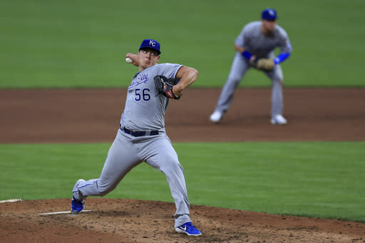 Kansas City Royals' Brad Keller (56) throws in the fifth inning during a baseball game against the Cincinnati Reds in Cincinnati, Wednesday, Aug. 12, 2020. (AP Photo/Aaron Doster)