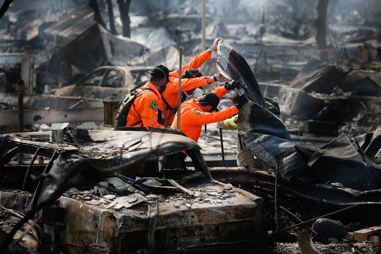 <p>Search and Rescue personnel look for human remains in the Journey's End Mobile Home park following the damage caused by the Tubbs Fire on Oct.13, 2017 in Santa Rosa, Calif. (Photo: Elijah Nouvelage/Getty Images) </p>