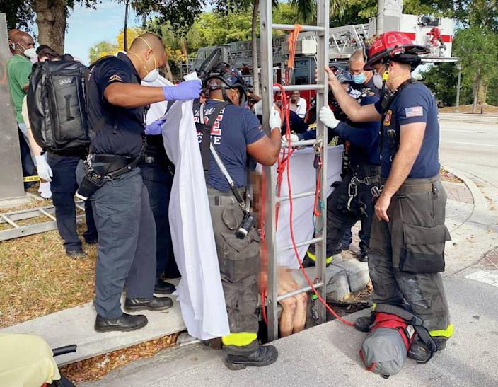 A naked woman was rescued Tuesday after she was found trapped inside a storm drain just a few feet away from a busy Delray Beach road, police and fire rescue said.
