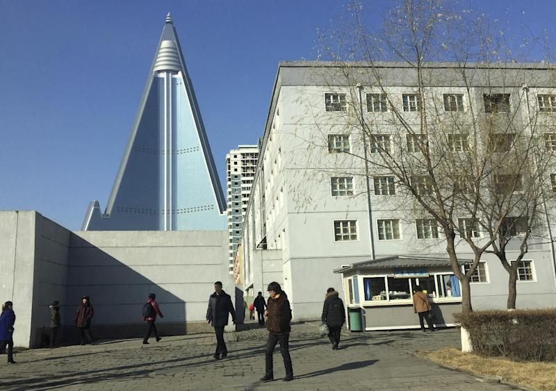 11, 2016 Photo, Residents Pass By The Towering Ryugyong Hotel