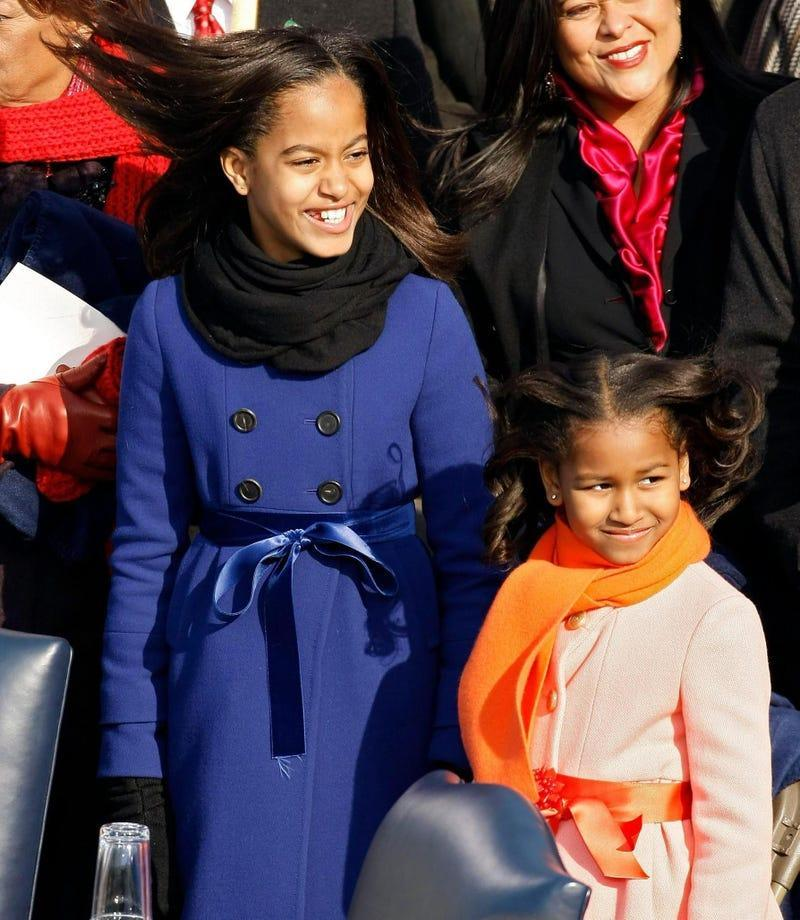 Malia and Sasha Obama stand on the stage ahead of the inauguration of Barack Obama as the 44th President of the United States of America on the West Front of the Capitol January 20, 2009 in Washington, DC.