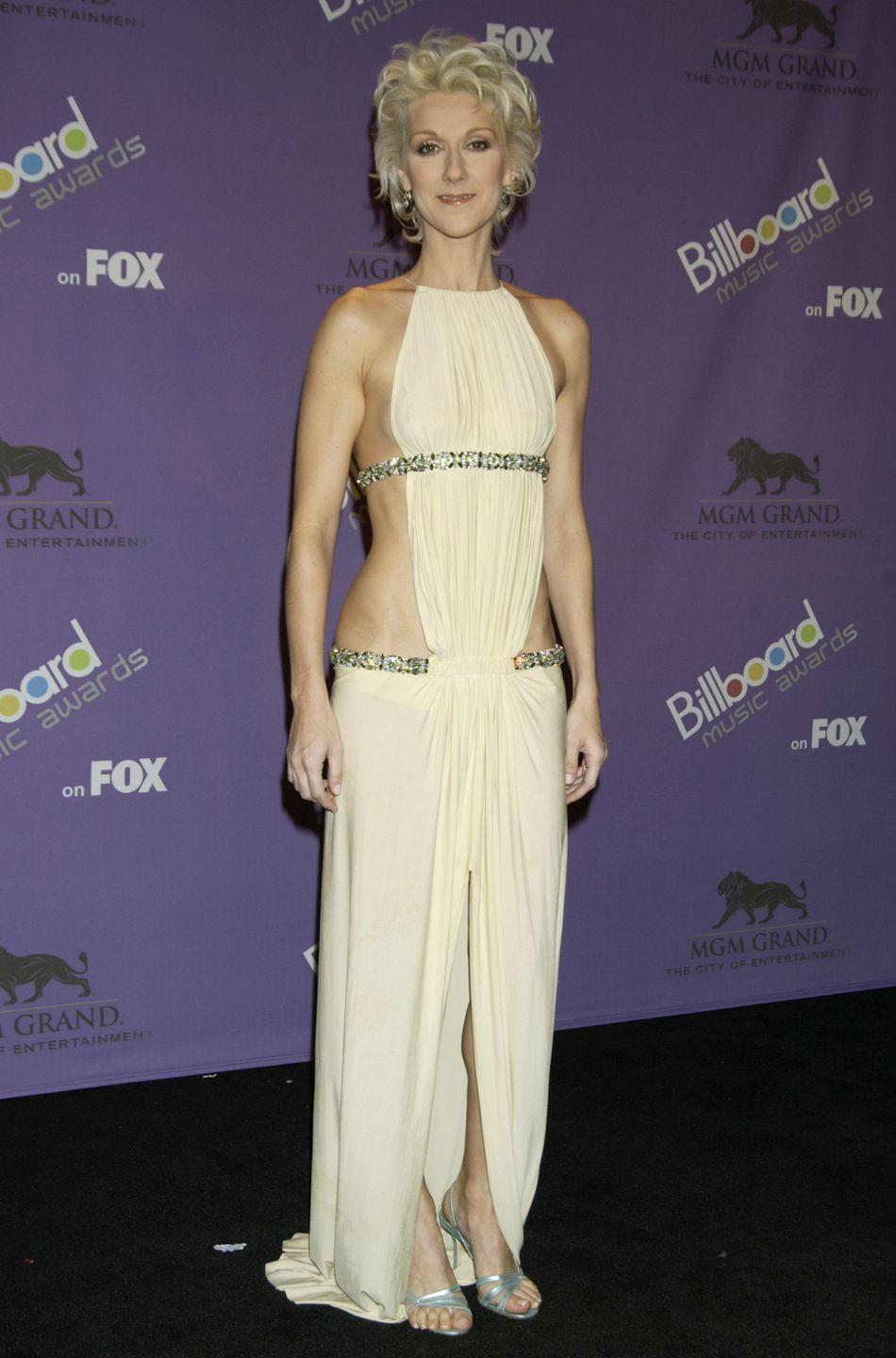 <p>Never one to hold back (vocally <em>and </em>sartorially), Dion wore a Athenian-inspired skin-baring gown on the Billboard Music Awards red carpet. </p>
