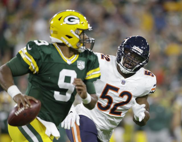 Chicago Bears' Khalil Mack rushes Green Bay Packers' DeShone Kizer during the first half of an NFL football game Sunday, Sept. 9, 2018, in Green Bay, Wis. (AP Photo/Jeffrey Phelps)