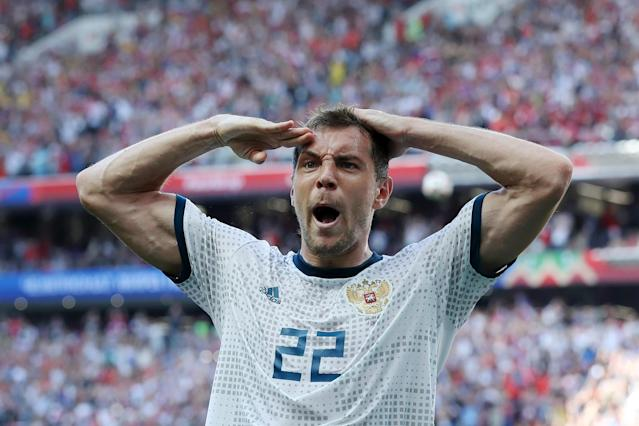 Artem Dzyuba celebrates his goal against Spain in Russia's stunning Round of 16 upset at the 2018 World Cup. (Getty)