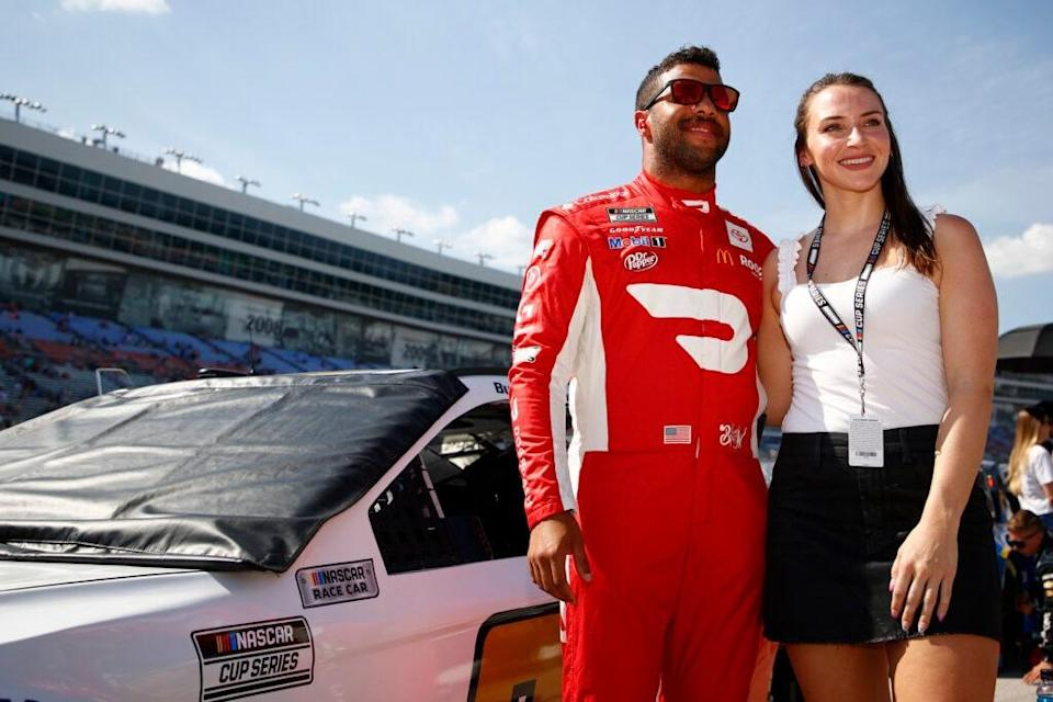 FORT WORTH, TEXAS – JUNE 13: Bubba Wallace, driver of the #23 Door Dash Toyota, poses for a photo on the grid with his girlfriend, Amanda Carter prior to the NASCAR All-Star Open at Texas Motor Speedway on June 13, 2021 in Fort Worth, Texas. (Photo by Jared C. Tilton/Getty Images)