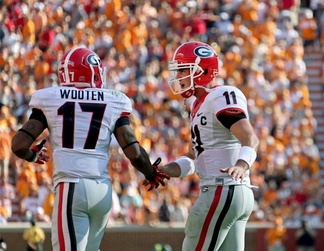 Georgia's Rantavious Wooten (17) celebrates his 4-yard touchdown catch with quarterback Aaron Murray (11) during the first half of an NCAA college football game in Knoxville, Tenn., Oct. 5, 2013. (AP Photo/Atlanta Journal-Constitution, Jason Getz)