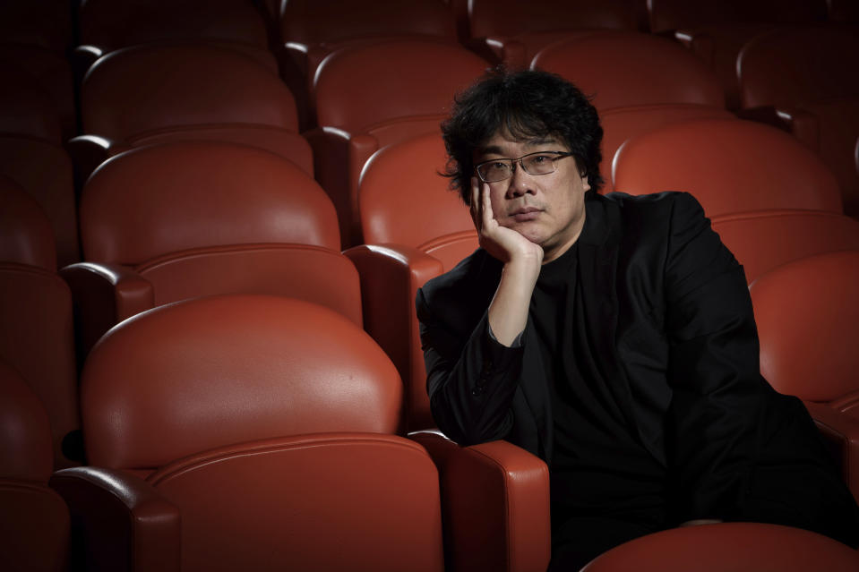 "This Oct. 8, 2019 photo shows filmmaker Bong Joon-Ho posing for a portrait at the Whitby Hotel screening room in New York to promote his film ""Parasite."" On Monday, Jan. 13, Joon-Ho was nominated for an Oscar for best director for his work on the film. (Photo by Christopher Smith/Invision/AP)"