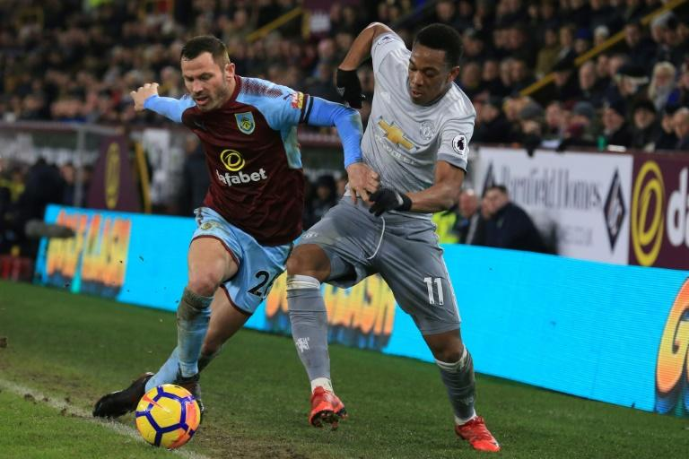 Manchester United's striker Anthony Martial (R) vies with Burnley's defender Phil Bardsley (L) during the English Premier League football match January 20, 2018