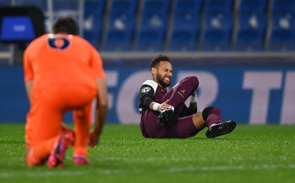 ISTANBUL, TURKEY - OCTOBER 28: Neymar of Paris Saint-Germain goes down injured during the UEFA Champions League Group H stage match between Istanbul Basaksehir and Paris Saint-Germain at Basaksehir Fatih Terim Stadyumu on October 28, 2020 in Istanbul, Turkey. Sporting stadiums around Turkey remain under strict restrictions due to the Coronavirus Pandemic as Government social distancing laws prohibit fans inside venues resulting in games being played behind closed doors. (Photo by Ozan Kose - Pool/Getty Images)