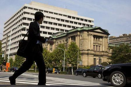 A man walks past the Bank of Japan (BOJ) building in Tokyo, October 30, 2015. REUTERS/Thomas Peter