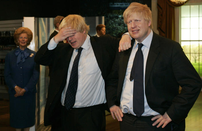 FILE - In this Tuesday, May 5, 2009 file photo then Mayor of London Boris Johnson, left, poses with a wax figure of himself at Madame Tussauds wax museum in London, after being introduced to his new wax figure. (AP Photo/Sang Tan, File)