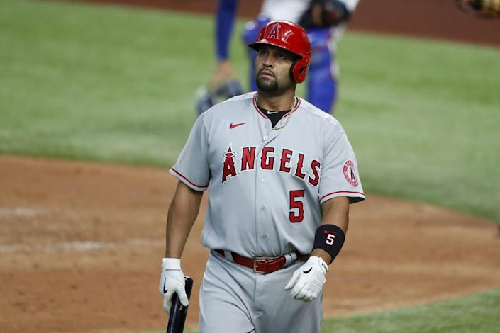 Albert Pujols walks to the dugout after fouling out.