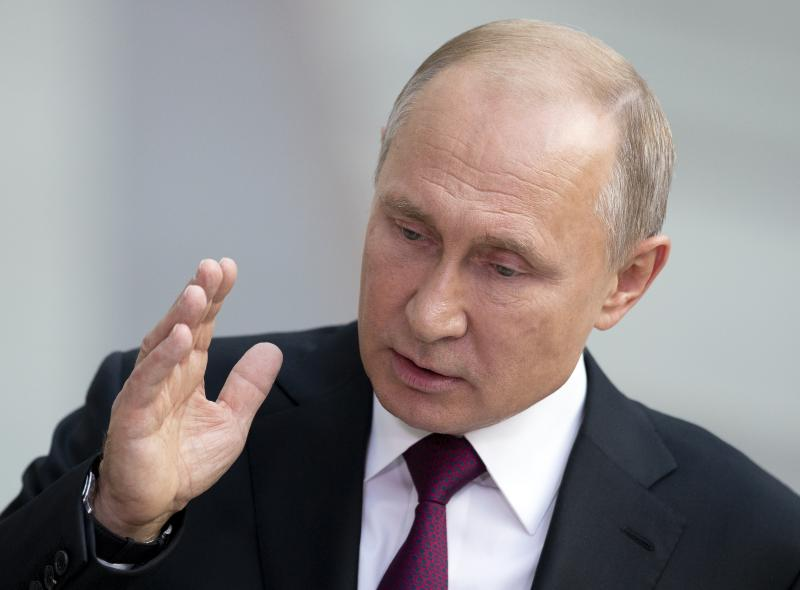 Russian President Vladimir Putin gestures answers a journalist's question after his annual call-in show in Moscow, Russia, Thursday, June 20, 2019. Putin hosts call-in shows every year, which typically provide a platform for ordinary Russians to appeal to the president on issues ranging from foreign policy to housing and utilities. (AP Photo/Alexander Zemlianichenko)