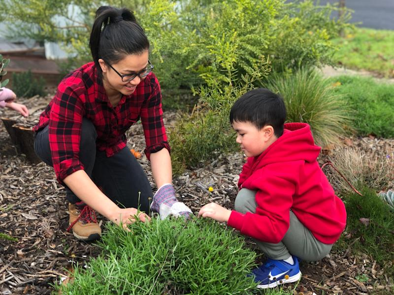 Daughter of Vietnamese refugees, Huong Truong lives in one of Melbourne's COVID-19 'hot spots', local government area Brimbank. Huong pictured here with her son. (Photo: Supplied/Huong Truong)
