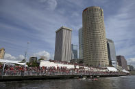 Fans watch the NFL football Tampa Bay Buccaneers celebrate their Super Bowl 55 victory over the Kansas City Chiefs with a boat parade in Tampa, Fla., Wednesday, Feb. 10, 2021. (AP Photo/Phelan Ebenhack)
