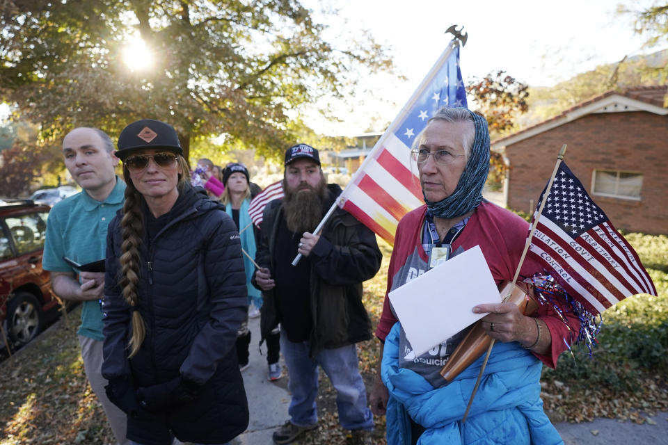 Anti-mask protestors march to the home of Utah Epidemiologist Dr. Angela Dunn Thursday, Oct. 29, 2020, in Salt Lake City. About a dozen protestors stood across from Dunn's home Thursday morning and evening. Utahns opposed to the Utah Department of Health's mask requirements are turning their scorn from Utah Gov. Gary Herbert to a new target this week state epidemiologist Dr. Angela Dunn. (AP Photo/Rick Bowmer)