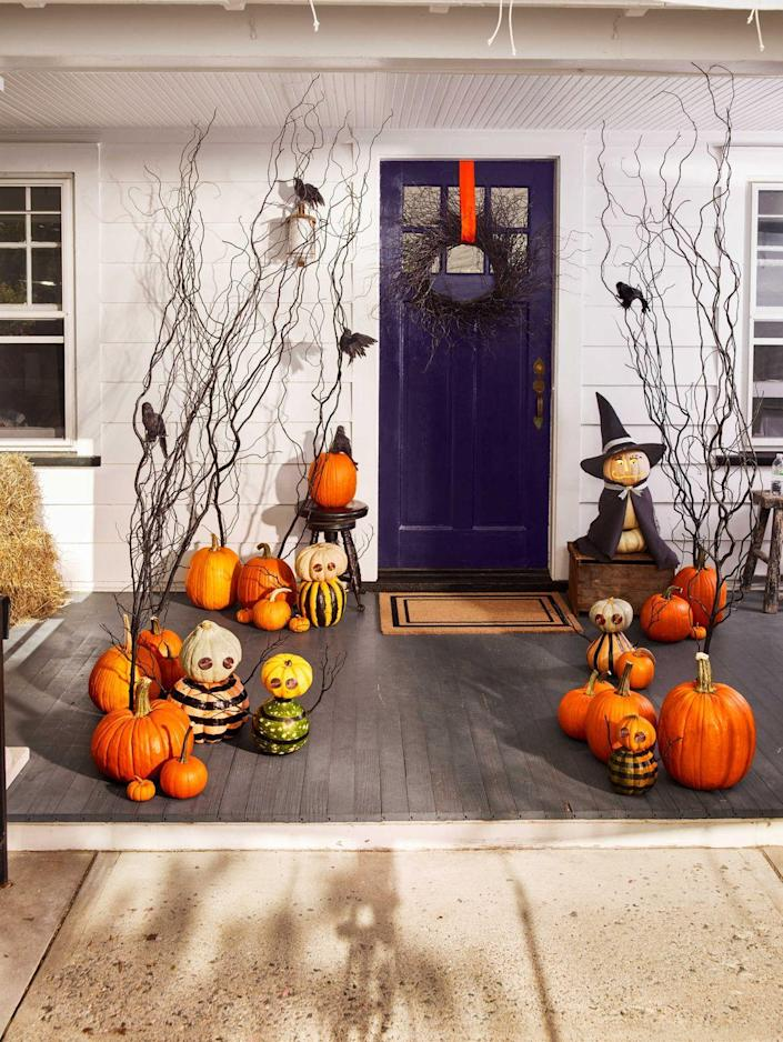 <p>Coiled aluminum-wire eyes that reflect light are a reminder that this ragtag team of ghouls is keeping watch over your house. Paint the body in your favorite patterns, stack a smaller pumpkin on top for the head, and add sticks for arms. <br></p>