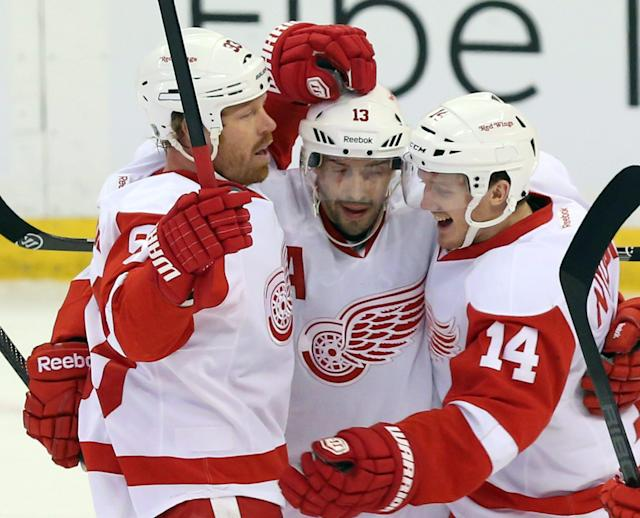 Detroit Red Wings' Johan Franzen (93) celebrates his goal with teammates Pavel Datsyuk (13) and Gustav Nyquist (14) during first period NHL hockey action against the Ottawa Senators in Ottawa, Thursday, Feb. 27, 2014. (AP Photo/The Canadian Press, Fred Chartrand)