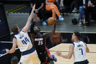 Miami Heat guard Kendrick Nunn (25) goes up for a shot against Dallas Mavericks forward Nicolo Melli (44) and center Dwight Powell (7) during the first half of an NBA basketball game, Tuesday, May 4, 2021, in Miami. (AP Photo/Wilfredo Lee)