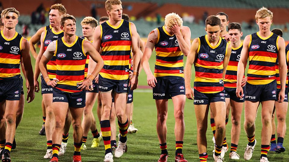 Adelaide Crows players, pictured here after their loss to Melbourne.