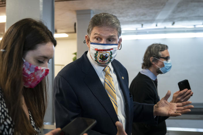 Sen. Joe Manchin (D-WV) speaks to reporters in the Senate subway following a vote at the U.S. Capitol on February 2, 2021 in Washington, DC. (Drew Angerer/Getty Images)