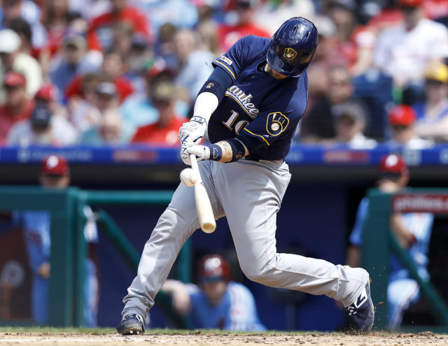 Milwaukee Brewers' Yasmani Grandal hits an RBI-sacrifice fly off Philadelphia Phillies starting pitcher Zach Eflin during the fifth inning of a baseball game, Thursday, May 16, 2019, in Philadelphia. (AP Photo/Matt Slocum)