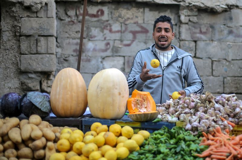 A Palestinian man sells vegetables in Khan Younis in the southern Gaza Strip