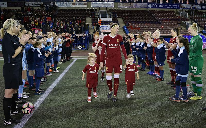 WIDNES, ENGLAND - FEBRUARY 21: (THE SUN OUT, THE SUN ON SUNDAY OUT) Casey Stoney of Liverpool Ladies walks out to a guard of honour with her three children before the FA WSL match between Liverpool Ladies and Sunderland Ladies at Select Security Stadium on February 21, 2018 in Widnes, England. (Photo by Andrew Powell/Liverpool FC via Getty Images)