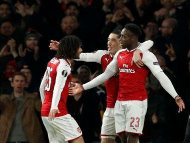 Danny Welbeck's controversial penalty and a Gianluigi Donnarumma howler helped Arsenal beat AC Milan in the Europa League 5-1 on aggregate, while Dortmund slumped to a shock exit at the hands of Salzburg.