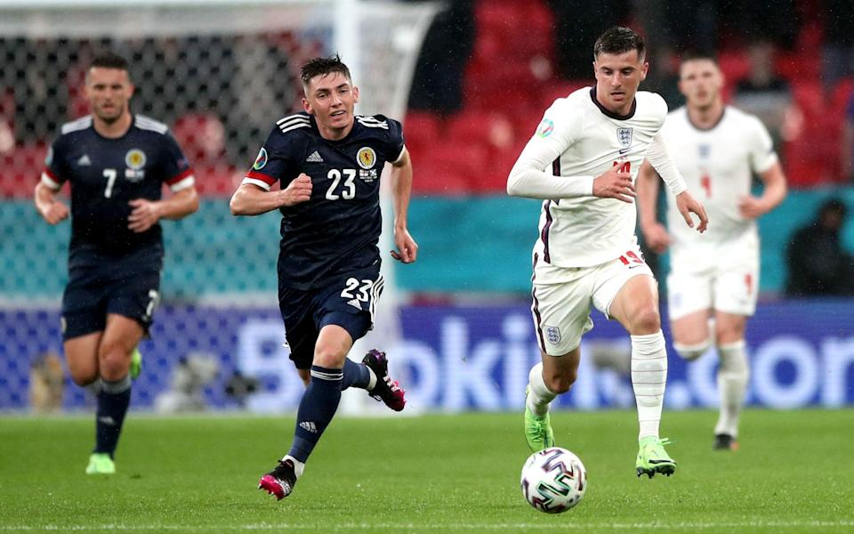 England's Mason Mount (right) and Scotland's Billy Gilmour in action during the UEFA Euro 2020 Group D match at Wembley Stadium, London. Picture date: Friday June 18, 2021. Issue date: Monday June 21, 2021. PA Photo. England duo Mason Mount and Ben Chilwell are isolating after coming into contact with Scotland midfielder Billy Gilmour, who has tested positive for Covid-19
