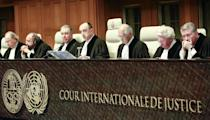 Judges from left: Mohamed Bennouna, Ronny Abraham, vice president Bernardo Sepulveda-Amor, president Peter Tomka, Hisashi Owada, Kenneth Keith and Leonid Skotnikov prior to the start of public hearings at the International Court of Justice (ICJ) in The Hague, Netherlands, Monday, March 3, 2014. Croatia is accusing Serbia of genocide during fighting in the early 1990's as the former Yugoslavia shattered in spasms of ethnic violence, in a case at the United Nations' highest court that highlights lingering animosity in the region. Croatia is asking the ICJ to declare that Serbia breached the 1948 Genocide Convention when forces from the former Federal Republic of Yugoslavia attempted to drive Croats out of large swaths of the country after Zagreb declared independence in 1991. (AP Photo/Jiri Buller)