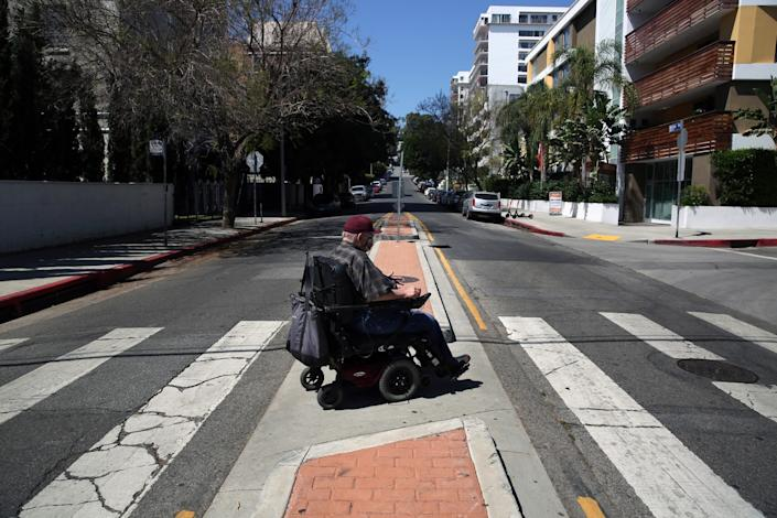 Gregory Kuhl, 69, returns to his street after shopping in Hollywood.